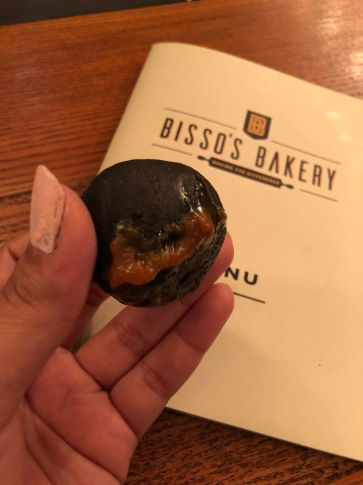 Charcoal Bun filled with butterscotch sauce
